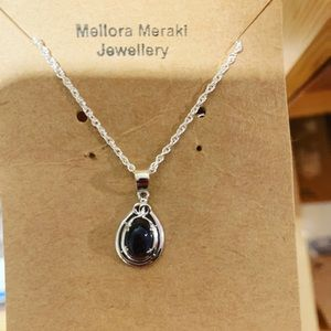Sterling silver pendant with Iolite